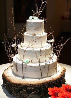 twig wedding cake on wood slice