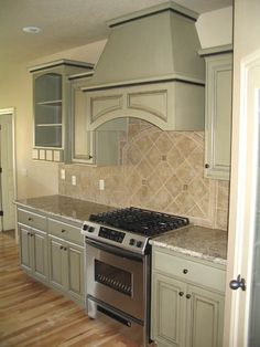 Stoneimpressions sage green inspiration from kraftmaid for Brushed sage kitchen cabinets