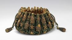 Gaming purse Date: late 17th century Culture: French Medium: silk, metal, leather, wood Dimensions: 2 1/4 x 4 1/4 in. (5.7 x 10.8 cm) Credit Line: Brooklyn Museum Costume Collection at The Metropolitan Museum of Art,