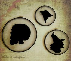 Pair up an old embroidery hoop, gossamer fabric, black felt, and some Halloween clip art to create awesome spooky silhouettes!