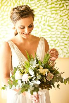loosely gathered bouquet of blue gum foliage, brunia berry, latte and ivory roses and tea tree living light photography