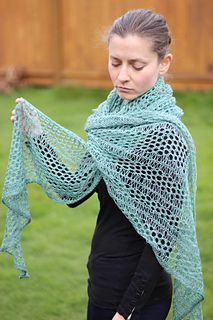 Drops of Honey is a large top down asymmetrical crescent shape shawl that combines the traditional Orenburg Honeycomb lace stitch with short rows and dropped stitches for easy elegance. Worked in lace weight wool, it's perfect for cool summer nights
