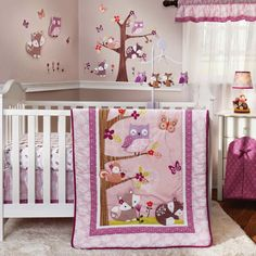 Cute owls, fox, squirrel, and other woodland creatures in this darling pink baby room set.