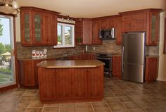 L shaped kitchen with window and sliding door at the same spot as our kitchen
