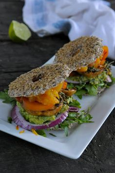 Take a turn and make a Raw Veggie burger with a sprouted Bagel, herb marinated mushrooms, lime guacamole and creamy apricots.