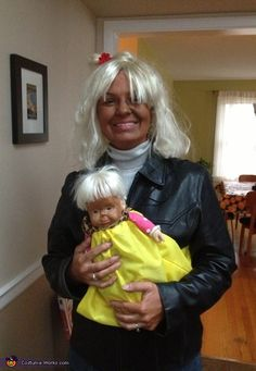 Mary: The idea is from the woman in the news who had some extreme tanning issues and took her child to a tanning bed with her. I used a blonde wig...