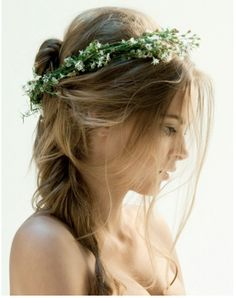Beautifully mussed hair with a wreath of flowers for a wedding in an open field