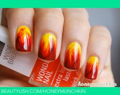 Fire by honeymunchkin - - Very Easy! Grab a normal art brush (thin) and paint wavy streaks from the tip up on a yellow nail. Start with orange, then red and then a dark red.