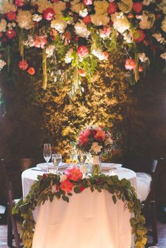 Floral wall at garden wedding reception - The Wedding Story of Eric and Kacey Bell | WeddingDay Magazine