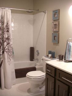 I like the color palette of chocolate brown, pale tan walls, cream/white and a little light blue. After: Boy-Friendly Bath - More Beautiful Bathroom Makeovers From Rate My Space on HGTV