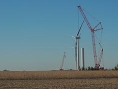 A crane lifts components to the top of a wind turbine tower as construction on four towers along U.S. 30 between Ames and Nevada continued on Friday, Oct. 7, 2016. Photo by Michael Crumb/Ames Tribune http://www.amestrib.com/news/20161007/rising-to-meet-wind
