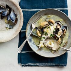 Based on the fisherman's stew he had in Greece, Andrew Zimmern simmers halibut in a lemony wine broth until tender and flaky then adds briny, succulent mussels.