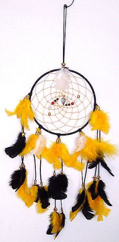 Black genuine suede wrapped around a 9-inch metal ring. The gold webbing is accentuated with Black and White Agate, blue and red glass beads, and brass beads with the Pittsburgh Steelers Logo in the center. The dreamcatcher is finished off with black tassels adorned with gold, black and white turkey t-feathers. Black Agate is used for calming and soothing anxiety. White Agate is used to promote general protection and tranquility. Show off your Steelers Pride with this beautiful dream catcher....