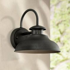 "Inspired by barn lighting and industrial style fixtures, this outdoor light comes with a built-in dusk-to-dawn motion sensor. 9"" high x 9 1/4"" wide. Extends 10 1/4"" from the wall. Backplate is 4 3/4"" wide. Weighs 1.98 lbs. Built-in 10 watt LED array. Non-dimmable. 3000K. 80 CRI. 750 lumens, comparable to a 60 watt incandescent bulb. Style # 8M841 at Lamps Plus."