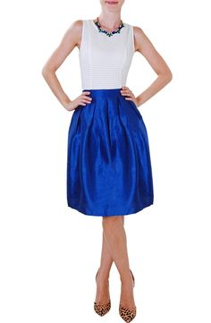 Made from a shimmering cotton blend fabric, this flattering A-line midi skirt features a fitted waist and flared cut.
