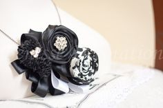 black handmade necklace with rhinestone version~    https://www.etsy.com/listing/100738447/100-handmade-fabric-flower-ribbon-of?ref=v1_other_2