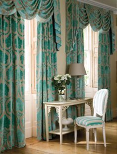 Traditional swags & panel draperies done in a contemporary turquoise color & pattern ..