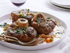 Osso Buco recipe from Giada De Laurentiis via Food Network. I am making this now, but I just make it the way I make beef stew. This recipe has additional touches like the wine, etc.