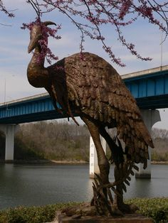"Art along trails: Chattanooga,  Sculpture at Fishing Park on the Tennessee Riverpark in Chattanooga, TN: ""Great Blue Heron with Olive Branch"" by artist Jack Denton, 2000. C. B. Robinson Bridge is in the background"