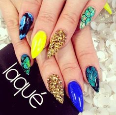 Royal blue, yellow, snake skin nails with golden Swarovski crystals.