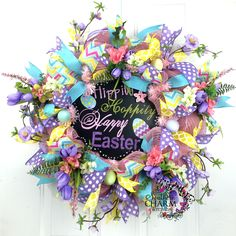 Deco Mesh Spring Wreath with Happy Easter Sign and Easter Eggs in Pink Blue and Lavender by www.southerncharmwreaths.com #easter #decor #diy
