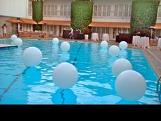 White 3-Foot Balloons on a Pool - love this for a party!