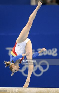 Romania's Sandra Izbasa competes on the floor during the women's team final of the artistic gymnastics event of the Beijing 2008 Olympic Games in Beijing on August China won the gold, while United States won the silver and Romania the bronze. Gymnastics Events, Gymnastics Pictures, Sport Gymnastics, Artistic Gymnastics, Olympic Sports, Olympic Games, Beijing Olympics, Acrobatic Gymnastics, Figure Skating