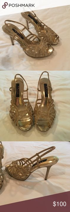 """Gold Heels Almost brand new golden, open-toe , sparkly high heels. Approx. """"4 heel. Lovely strap detail on top of the foot/over the toes. I love these shoes. I've only worn them 2-3 times. Very light wear on the soles. I am willing to negotiate, so please make an offer. Nina Shoes Heels"""