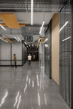 American studio Tighe Architecture used plywood, perforated steel and white LEDs to revamp public spaces in a pair of nondescript, 50-year-old office buildings in the Los Angeles area.