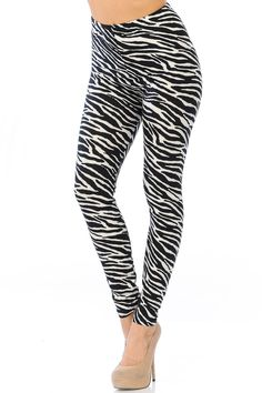 Fierce fashionistas will love our Brushed Zebra Leggings, The sassy black and white striped animal print design will add a zesty touch to your outfits. Combine that with a silky soft lightweight fabric plus a flattering body-hugging fit, and what's not to love?  .  .  .  #leggings #onlyleggings #activewear #colorful #fashion #style #instastyle #comfyclothes #boutique #leggingslove #leggingsaddict #leggingsfordays #leggingssport Camouflage Leggings, Print Leggings, Colorful Fashion, New Fashion, Black And White Leggings, Glen Plaid, Plus Size Leggings, Plaid Design