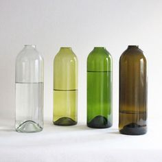 $16.00  Elegant glass water or wine carafe cut and finished off by hand from reclaimed wine bottles by members of a skills training centre in South Africa for Deep Dark Africa.