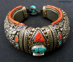 India | A Tibetan hand made bracelet | Sterling silver, brass, coral and turquoise