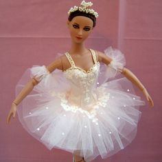 I made this Aurora Rose tutu for a doll belonging to a young Australian ballet student. It took a long time to cut out and hand applique all the lace motifs but was worth it in the end. By Louise Goldsborough/Bird of Angelique Miniatures.