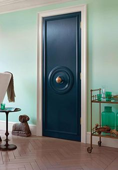 Accessorize a hollow-core door: One ceiling medallion and some hardware later, you have a formerly blah door that looks super custom and expensive.