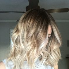 Rooted blonde lob by Jamie Garland