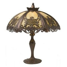 Luxury Lighting is pleased to supply Kansa Lightings Rococo range. Colonial New Orleans Style interior lights with an intricate antique finish metalwork shade and amber-white glass. Elegant home lighting. Lamp Shade, Floor Table, Table Lamp, Table Style, Victorian Table Lamps, Lamp Light, Tiffany Lamps, Vintage Lamps, Luxury Lighting