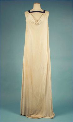 A silk jersey evening gown, ca. 1973, by the Parisian couture designer Madame Grès. Established in Paris in the 1940s, Madame Grès produced classic and elegant couture designs for famous women like Greta Garbo and Marlene Dietrich. Grès was known for sculpting fabric directly on model's bodies, making each dress a unique piece of art