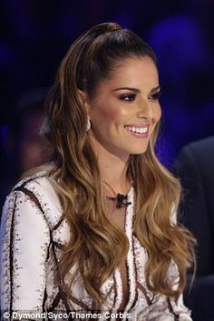 Sleek and chic: While both female judges opeted for white ensembles, they both kept their hair and make-up sophisticated, with Cheryl opting for a long flowing ponytail and Mel going for a slicked back vibe