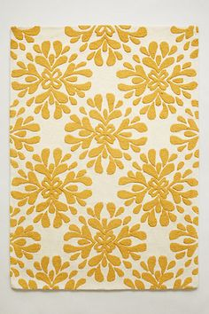 I LOVE yellow! Too bad my kids would destroy this! Coqo Floral Rug #anthropologie