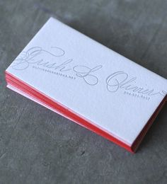 The delight is in the details of this business card designed by Dingbat Press. It features Spencerian Script Calligraphy on letterpress printed on 110# lettra paper, with Gravely/Cement ink and a red edge-paint.
