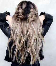Teased, pulled apart pigtail braids starting at the top of the head and ending below the crown. Love this beachy, wavy hair.