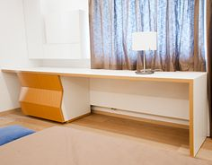 """The simple """"L"""" shaped desk has the natural oak finished drawers as its visual base, faces of the drawers being designed at different inclinations. This detail is a diagonal response to the one near the entrance in this room.The length of the desk is dict… L Desk, L Shaped Desk, Corner Desk, Entryway Tables, Drawers, Furniture Design, Curtains, The Originals, Simple"""