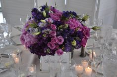 he arrangements consisted of different shades of pink and purple flowers including peonies, anemones, garden roses, lisianthus, and spray roses.