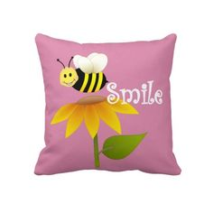 """Happy Bee Pillow $72 Throw Pillow 20"""" x 20""""  Accent your home with custom pillows. Made of 100% grade A cotton. The perfect complement to your couch, custom pillows will make you the envy of the neighborhood.      Sizes 20""""x20"""" (square) and 13""""x21"""" (lumbar).     100% grade A woven cotton.     Fabric is made from natural fibers, which may result in irregularities     Made in the USA.     Hidden zipper enclosure; synthetic-filled insert included.     Machine washable."""