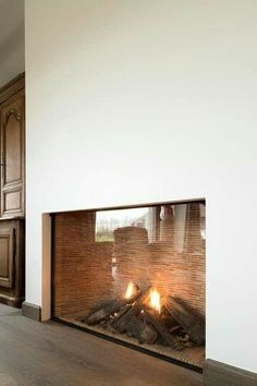 A modern fireplace instantly become a breathtaking focal point for any room, but with new advances in energy efficiency. - A modern fireplace instantly become a breathtaking focal point for any room, but with new advances in energy efficiency. Fireplace Built Ins, Home Fireplace, Fireplace Surrounds, Fireplace Design, Modern Fireplaces, Fireplace Ideas, Fireplace Outdoor, Corner Fireplaces, Tiled Fireplace