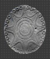 Estrella de ocho puntas,tallada en andrasita,posclasico tardio,1200-1521  Museo Nacional de Antropologia  Se usaba para el ritual asociado a Venus,a la que llamaban Huey Citlali,la Gran Estrella.