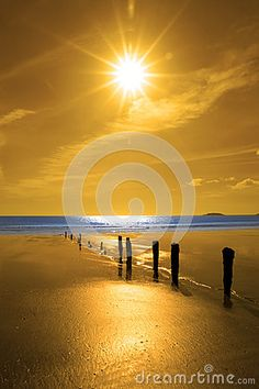 Golden sunrise over the beach and breakers