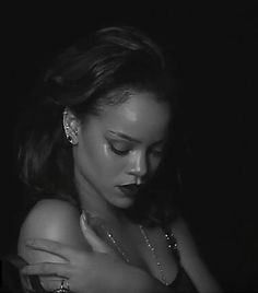 A sheet turned gray by the black-and-white aesthetic, blows furiously from an unseen wind. Dice roll back and forth, then multiply as Rihanna stays covered.