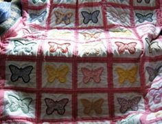 Classic butterfly quilt...My grandmother made me a butterfly quilt with purple backing.