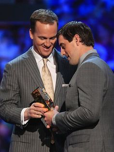 Peyton Manning presenting Aaron Rodgers the AP MVP Player of the Year award.